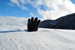 Glove and snow Royalty Free Stock Photos