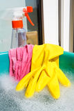 Glove, wet rag, spray bottle, foamy water Stock Image