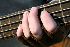 Gloved Fingers on Frets Royalty Free Stock Photos