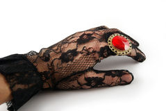 Gloved hand Stock Images