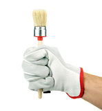 Gloved hand with brush Stock Photo