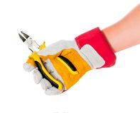 Gloved hand with cutters Royalty Free Stock Image
