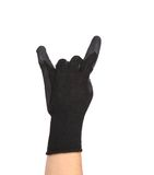 Gloved hand giving the Rock and Roll sign. Royalty Free Stock Images