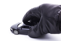 Gloved Hand is holding a car Stock Images
