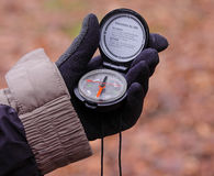 Gloved Hand holding a Compass Stock Photography
