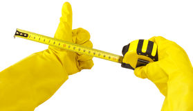 Gloved hand holding measuring tape isolated Stock Photo