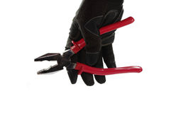 Gloved hand holding a pliers Royalty Free Stock Photography