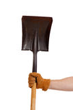A gloved hand holding a shovel Royalty Free Stock Images