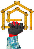 Gloved Hand Holding a Symbolic House Stock Photos