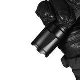 Gloved Hand Holding Tactical Flashlight, Bright Light Emiting Brightly Lit, Serrated Strike Bezel, Black Grain Leather Glove Stock Images