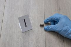 The gloved hand raises the cartridge from the cartridge, the investigation, the evidence, a close-up royalty free stock photos