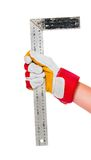 Gloved hand with ruler Stock Photos