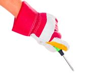 Gloved hand with screwdriver Royalty Free Stock Images