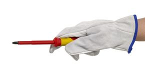 Gloved hand with screwdriver Royalty Free Stock Photography