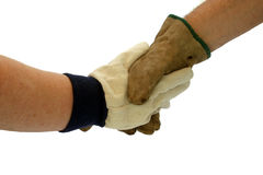 Gloved hand shake. New and old gloves shaking hand - business concept of old handing over to new royalty free stock photography