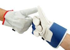 Gloved hand signalerende duim omhoog. stock fotografie