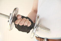 Gloved hand with weight Royalty Free Stock Photo