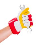 Gloved hand with wrench Stock Image