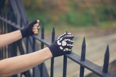 Gloved hands grabbing railings Stock Images