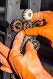 Gloved ręki naprawia przekładnie fotografii drukarka Zdjęcie Royalty Free
