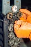 Gloved ręki naprawia przekładnie fotografii drukarka Obrazy Royalty Free