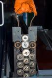 Gloved ręki naprawia przekładnie fotografii drukarka Zdjęcia Stock