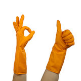 Gloved symbol. Thumb up symbol in rubber glove and ok symbol royalty free stock photography