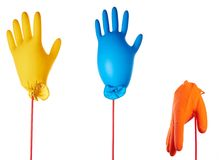 Gloves. Two air-filled colorful latex gloves and inflate one Royalty Free Stock Images