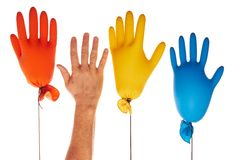 Gloves. Colorful latex gloves and the hand Stock Photography