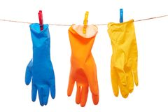 Gloves. Colorful gloves hanging on the rope Stock Photo