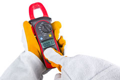 Gloves acting with a clamp multimeter Royalty Free Stock Photo