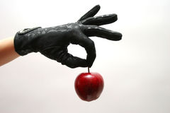 Gloves & Apple. Gloves-apple stock photography