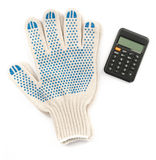 Gloves with calculator Royalty Free Stock Photo