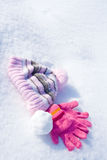 Gloves, cap and snowball Stock Photo