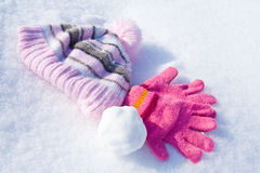 Gloves, cap and snowball Royalty Free Stock Photo