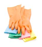 Gloves on colored rags Royalty Free Stock Images