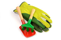Gloves with garden tools Royalty Free Stock Photos