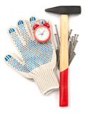Gloves with hammer and alarm clock Stock Images