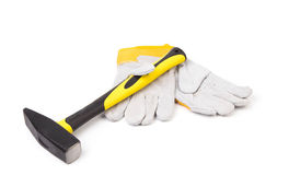 Gloves and hammer Royalty Free Stock Photos