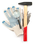 Gloves with hammer and loupe Royalty Free Stock Photo