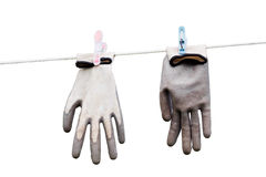 Gloves hanging on a rope. Gloves hanging on the rope isolated on white background Stock Image