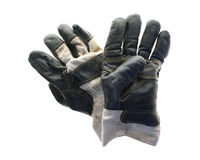 Gloves, hard work, business. Work or gardening gloves isolated. illustrates working man, trade,labouring or business methaphor for hard work Stock Photography