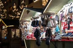Gloves and hats on christmas market booth in merano south tyrol during night royalty free stock photos