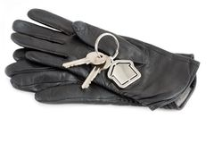 Gloves with house keys Stock Photography