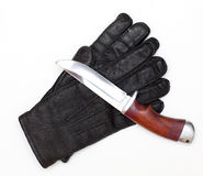 Gloves and knife Royalty Free Stock Photo