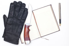 Gloves and knife Stock Image