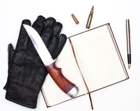 Gloves and knife Stock Photos