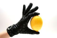 Gloves & Lemon Royalty Free Stock Photography