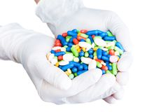 Gloves with many pills Royalty Free Stock Image