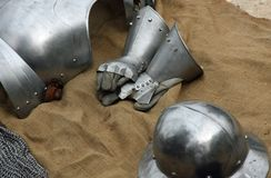 Gloves and metal armor with a helmet during the medieval spectac Royalty Free Stock Photo